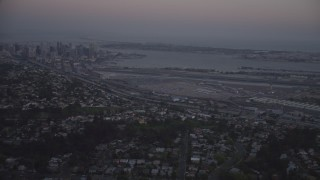 DCA08_330 - 4K stock footage aerial video of Downtown San Diego and San Diego International Airport, California, twilight