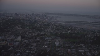 DCA08_331 - 4K stock footage aerial video of flying by Downtown San Diego, and San Diego International Airport, California, twilight