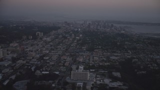 DCA08_332 - 4K stock footage aerial video of Downtown San Diego skyscrapers seen from Clairemont, California, twilight