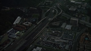 DCA08_333 - 4K stock footage aerial video fly away from freeway interchange, reveal a strip mall, Mission Valley, California, twilight