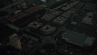 DCA08_335 - 4K stock footage aerial video fly away from apartment buildings and reveal a freeway, Mission Valley, California, twilight