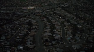 DCA08_338 - 4K stock footage aerial video of tract homes in the suburbs, Serra Mesa, California, twilight