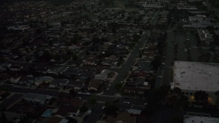 DCA08_339 - 4K stock footage aerial video of tract homes and apartment buildings, Serra Mesa, California, twilight