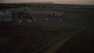 DCA08_340 - 4K stock footage aerial video of landing at Montgomery Field airport in California, twilight
