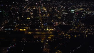 DCA08_343 - 4K stock footage aerial video of skyscrapers, hotels and convention center at night in Downtown San Diego, California