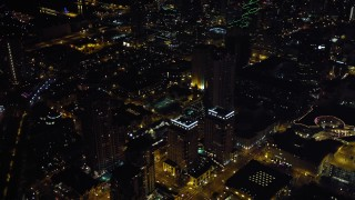 DCA08_346 - 4K stock footage aerial video approach and tilt to city skyscrapers in Downtown San Diego, California, Night