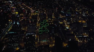 DCA08_347 - 4K stock footage aerial video orbit city buildings and tilt to skyscrapers, Downtown San Diego, California, Night