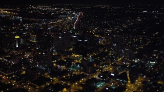 DCA08_352 - 4K stock footage aerial video of panning from sports stadium to skyscrapers in Downtown San Diego, California, Night