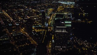 DCA08_354 - 4K stock footage aerial video of panning across the city to reveal a luxury waterfront hotel, Downtown San Diego, California, Night