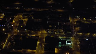 DCA08_357 - 4K stock footage aerial video of tracking cars on the freeway, Downtown San Diego, California, Night
