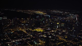 DCA08_359 - 4K stock footage aerial video of tilting from city buildings to skyscrapers, Downtown San Diego, California, Night