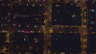 DCA08_361 - 4K stock footage aerial video of a bird's eye view of city streets, reveal skyscrapers in Downtown San Diego, California, Night