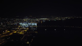 DCA08_364 - 4K stock footage aerial video of panning across downtown to reveal the Coronado Bridge and San Diego Bay, California, Night