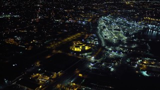 DCA08_365 - 4K stock footage aerial video approach Port of San Diego and pan to Logan Heights suburban houses in California, Night