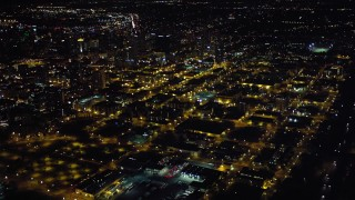 DCA08_366 - 4K stock footage aerial video approach downtown and pan to skyscrapers, Downtown San Diego, California, Night