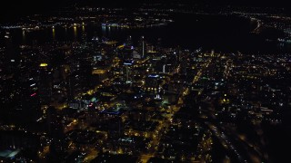 DCA08_369 - 4K stock footage aerial video of flying by city skyscrapers in Downtown San Diego, California, Night