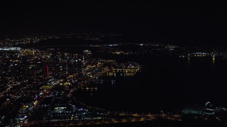 DCA08_373 - 4K stock footage aerial video of flying by skyscrapers and part of the bay, Downtown San Diego, California, Night
