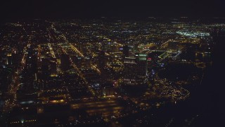 DCA08_375 - 4K aerial stock footage video of panning from luxury hotels to skyscrapers at night in Downtown San Diego, California