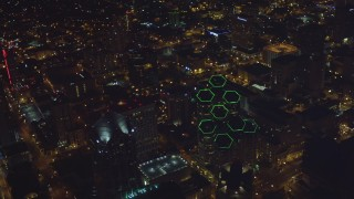 DCA08_376 - 4K aerial stock footage video approach and tilt to the tops of skyscrapers, Downtown San Diego, California, Night