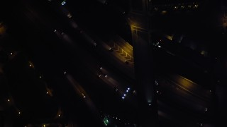 DCA08_377 - 4K stock footage aerial video of a bird's eye of city streets and skyscrapers, reveal the freeway, Downtown San Diego, California, Night