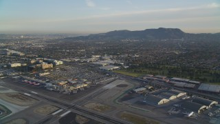 DCLA_002 - 5K stock footage aerial video fly over runways at Burbank Airport and tilt to terminals at sunset, California