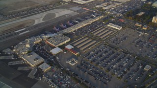 DCLA_004 - 5K stock footage aerial video orbit main terminals and parking lots at sunset at Burbank Airport, California