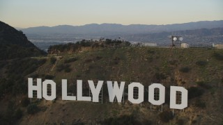 DCLA_007 - 5K stock footage aerial video tilt to reveal and fly over the Hollywood Sign at sunset, California