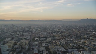 DCLA_022 - 5K stock footage aerial video approach Hollywood from Downtown Los Angeles, California at sunset
