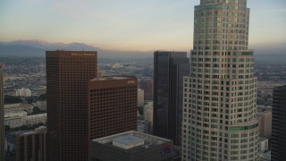 DCLA_027 - 5K stock footage aerial video fly over and approach tower at sunset in Downtown Los Angeles, California