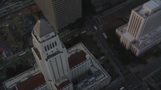 DCLA_029 - 5K stock footage aerial video approach Los Angeles City Hall at sunset in Downtown Los Angeles, California