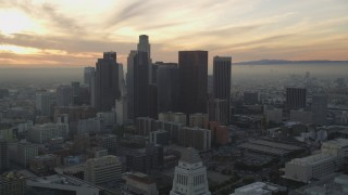 DCLA_030 - 5K stock footage aerial video tilt from City Hall to reveal skyline at sunset in Downtown Los Angeles, California