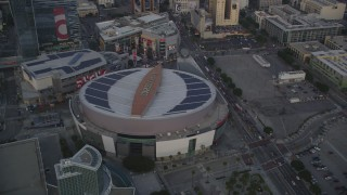 DCLA_041 - 5K stock footage aerial video tilt from Staples Center to reveal Downtown Los Angeles at sunset, California
