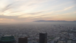 DCLA_050 - 5K stock footage aerial video of Century City seen from Downtown Los Angeles at sunset, California