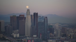 DCLA_062 - 5K stock footage aerial video of full moon over Downtown Los Angeles skyscrapers at twilight, California