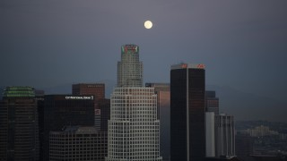 DCLA_080 - 5K stock footage aerial video orbit The Ritz-Carlton to reveal Downtown Los Angeles towers and full moon at twilight, California