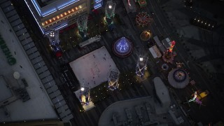 DCLA_083 - 5K stock footage aerial video bird's eye orbit of ice skating rink and fair in Downtown Los Angeles at twilight, California