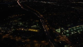 DCLA_088 - 5K stock footage aerial video fly over light traffic on Interstate 5 through San Fernando at night, California