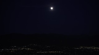 DCLA_093 - 5K stock footage aerial video of full moon over San Fernando Valley at night, California