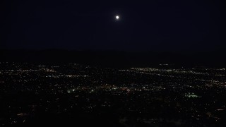 DCLA_094 - 5K stock footage aerial video of full moon over suburban neighborhoods in the San Fernando Valley at night, California