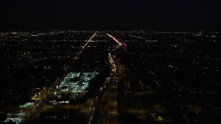 DCLA_095 - 5K stock footage aerial video fly over light traffic on I-5 through San Fernando, California at Night