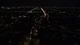DCLA_096 - 5K stock footage aerial video fly over I-5, tilt to reveal 118 interchange at night in San Fernando, California