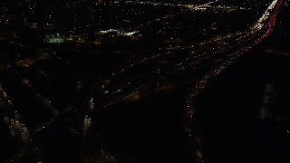 DCLA_097 - 5K stock footage aerial video of I-5 and 118 interchange at night in San Fernando, California