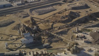 DCLA_100 - 5K stock footage aerial video orbit quarry buildings in Pacoima, California