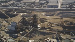 DCLA_101 - 5K stock footage aerial video orbit of quarry buildings in Pacoima, California