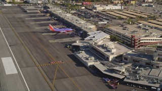 DCLA_105 - 5K stock footage aerial video fly low over runway and approach terminals at Burbank Airport, California