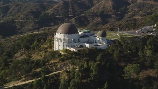DCLA_110 - 5K stock footage aerial video orbit east side and front of the Griffith Observatory in Los Angeles, California