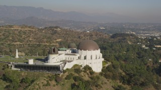 DCLA_112 - 5K stock footage aerial video orbit west side of the Griffith Observatory in Los Angeles, California