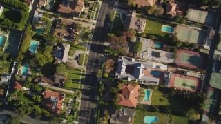 DCLA_117 - 5K stock footage aerial video of a bird's eye view of a street lined with mansions in Beverly Hills, California