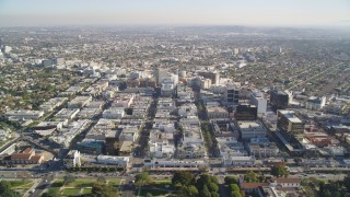 DCLA_118 - 5K stock footage aerial video tilt from Beverly Hills mansions to reveal shops and office buildings by Santa Monica Boulevard, California