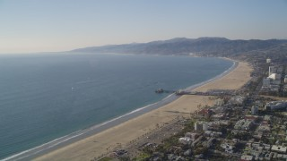 DCLA_121 - 5K stock footage aerial video approach the beach and Santa Monica Pier in California